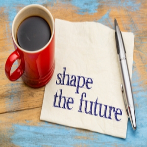Shape the future - motivational phrase on a napkin with a cup of coffee